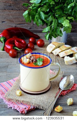 Roasted tomato and sweet pepper soup with anchovy on top