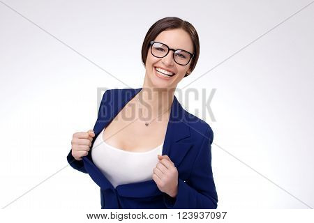 Sexy young businesswoman taking off her jacket and showing her perfect breasts