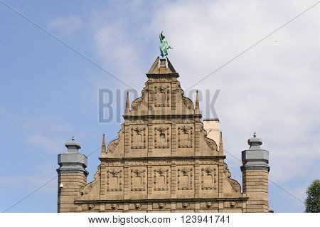 TORUN, POLAND - JULY 7, 2009: Gable of the Collegium Maximum building of the Nicolaus Copernicus University with the statue of fortune at the top