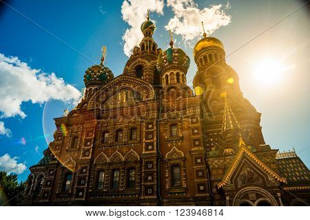 Church of the Savior on Blood against bright sun with lens flare in Saint-Petersburg, Russia. One of the main touristic attractions in the city.