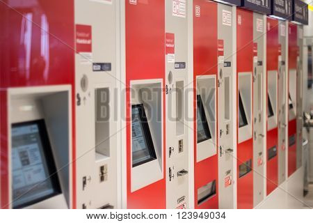 Berlin, Germany - march 30, 2016: Train ticket vending machines of the german railroad company (Deutsche Bahn) at berlin main station (Berlin Hauptbahnhof).