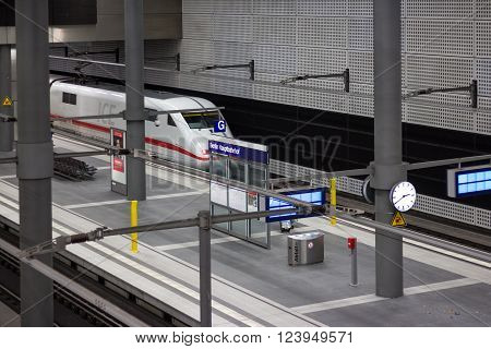 Berlin, Germany - march 30, 2016: Empty train station and ICE train in berlin main station( Berlin Hauptbahnhof) in berlin, germany.