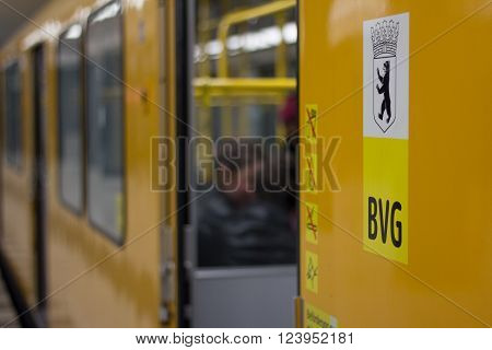 Berlin, Germany - march 30, 2016:  Closeup of the public transportation company  logo (BVG) and the berlin emblem (berlin bear) on metro train.