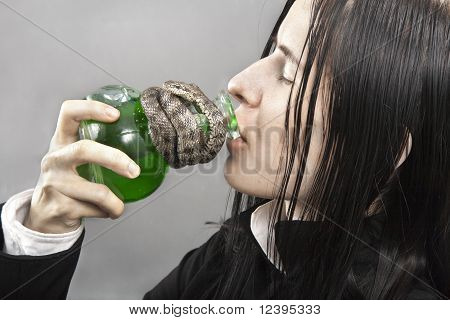 The Person Drinks Poison From A Flask