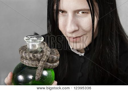 The Person In The Black Holding Flask Of Poison