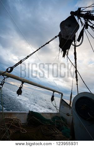 At the stern of a fishing vessel in the evening. Sea of Japan.