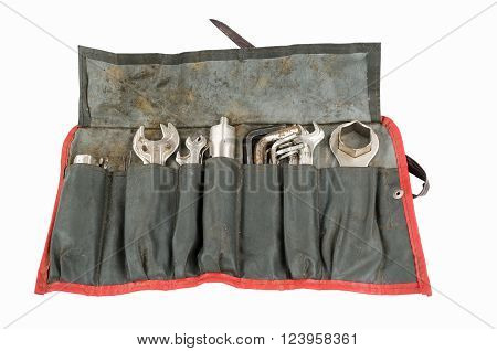 Old tool roll carried on an antique motorcycle for many miles. From back in the days when you could make your own repairs on the road.