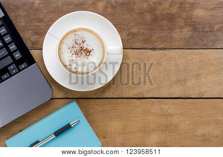 Office stuff with laptop, notebook, pen and coffee cup.top view with copy space
