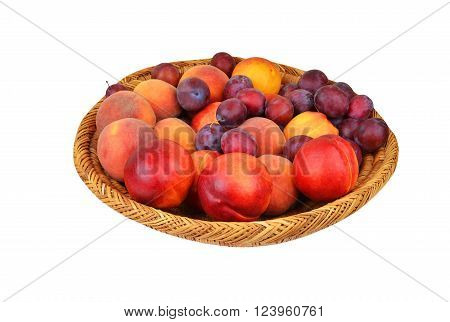 Fruits in wattled basket isolated on white
