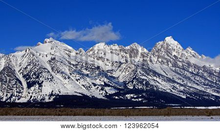 Mount Woodring of the Grand Tetons Peaks in Grand Tetons National Park under a lone cloud
