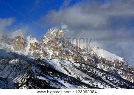 Mount Woodring of the Grand Tetons Peaks in Grand Tetons National Park shrouded in clouds and mist