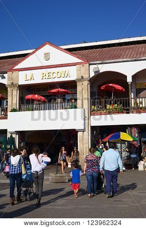 LA SERENA, CHILE - FEBRUARY 27, 2015: Unidentified people walking towards La Recova municipal market in the city center on February 27, 2015 in La Serena, Chile. La Recova houses mainly artisan shops and restaurants.