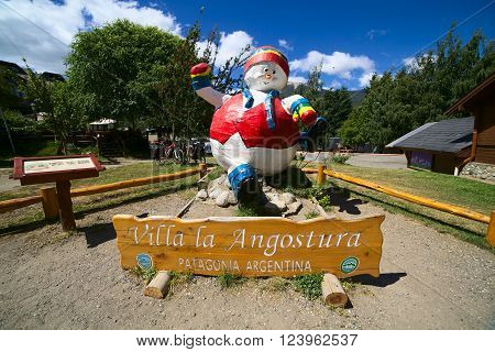 VILLA LA ANGOSTURA, ARGENTINA - JANUARY 12, 2016: Snowman statue standing next to the bus terminal, photographed on January 12, 2016 in Villa la Angostura, Argentinian Patagonia. Villa la Angostura is a popular tourist destination.