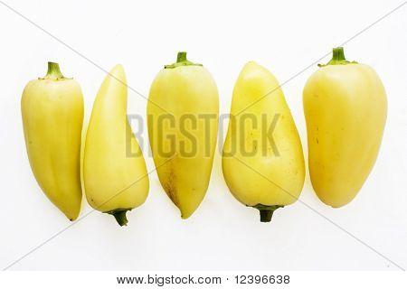 yellow bellpeppers in line