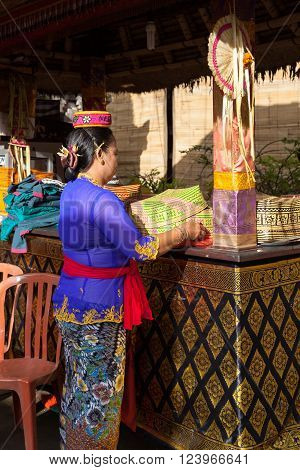 UBUD, INDONESIA - MARCH 2: Woman with basket in the hands during the celebration before Nyepi (Balinese Day of Silence) on March 2, 2016 in Ubud, Indonesia.