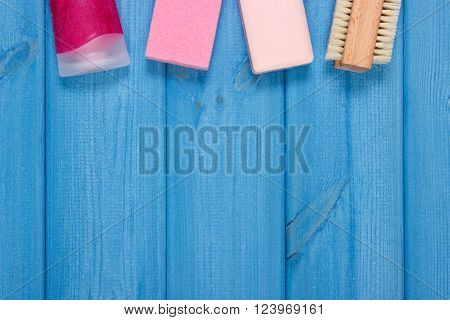 Cosmetics and accessories for personal hygiene in bathroom, soap, body scrub, brush, pumice, concept of body care, copy space for text