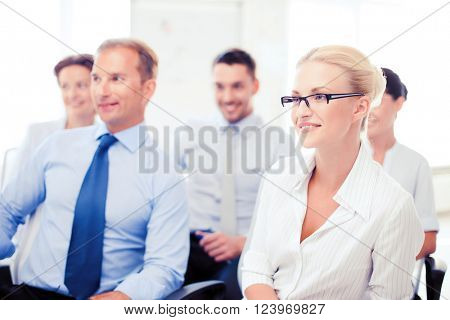 business concept - smiling businessmen and businesswomen on conference