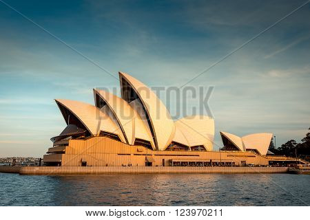 Sydney Australia - November 10, 2016: Opera House at sunset. View from the arriving ferry. Color toning effects applied.