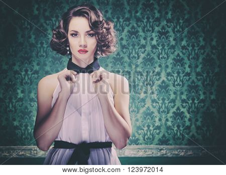 Gorgeous Woman On Vintage Type Wall With Retro Look