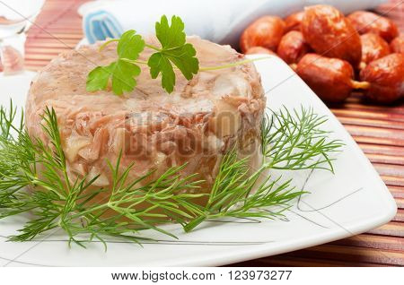 Traditional russian New Year's food - meat in aspic