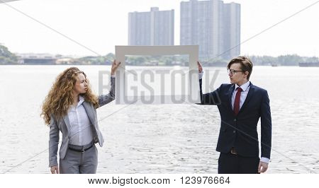 Business People  Picture Frame River Holding Concept