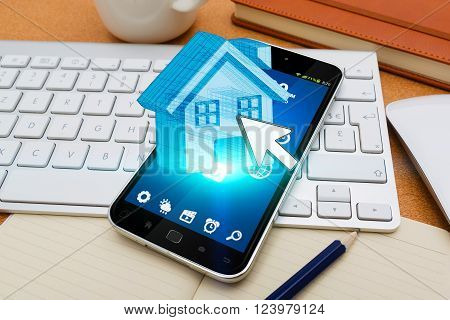 Modern mobile phone in office with real estate application