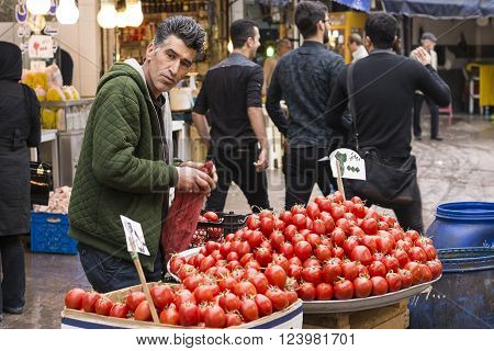 Gilan Province- Rasht IRAN-March 26 2016- Daily Bazaar Middle Age Man Brought Tomato's for Sale