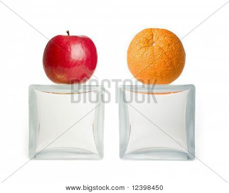 apple and orange on glass vases