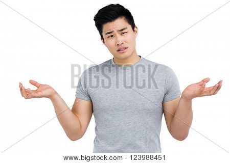 Portrait of worried man gesturing on white background