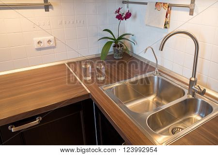 cups of water on countertop in modern kitchen