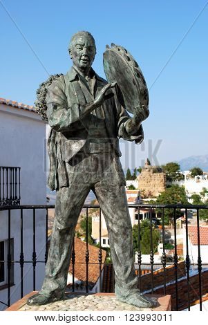 COMARES, SPAIN - JUNE 29, 2008 - Statue of Antonio Miguel Gallego Romero with views towards castle and town Comares Malaga Province Andalusia Spain Western Europe, June 29, 2008.