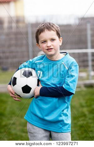 7 Years Boy - Footballer With Football Ball.