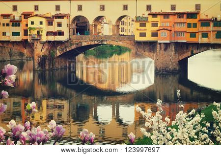 famous bridge Ponte Vecchio close up over river Arno at spring, Florence, Italy, retro toned