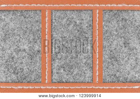 Background of close up on gray fabric texture and brown leather which separated in three parts
