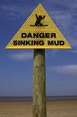 stock photo of quicksand  - Danger sinking mud sign - JPG