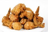 image of fried chicken  - pile of crispy golden brown fried chicken on a white background - JPG