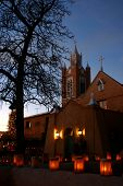 stock photo of luminaria  - christmas eve luminarias around the san felipe de neri church in old town albuquerque nm - JPG