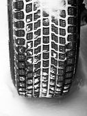 stock photo of mud pack  - Mud and snow tire tread packed with snow - JPG
