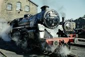 stock photo of loco  - 75078 Standard Class 4 Steam Loco and 30072 Tank Engine Outside Haworth Engine Shed Keighley and Worth Valley Railway  - JPG