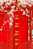 stock photo of customary  - chinese red lantern with colourful decoration in front  - JPG