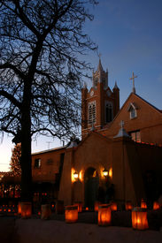 pic of luminaria  - christmas eve luminarias around the san felipe de neri church in old town albuquerque nm - JPG