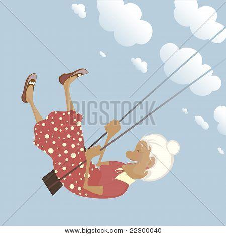 A happy shildish granny on the swing