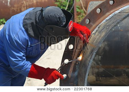 A Welder Working With A Metal Pipe