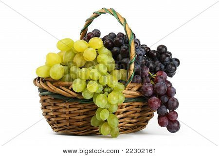 Clusters Of Yellow And Black Grapes In A Basket On A White Background