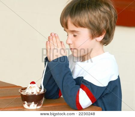 Boy Praying Before Dessert