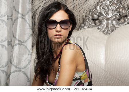 Attractive young woman in elegant sun glasses