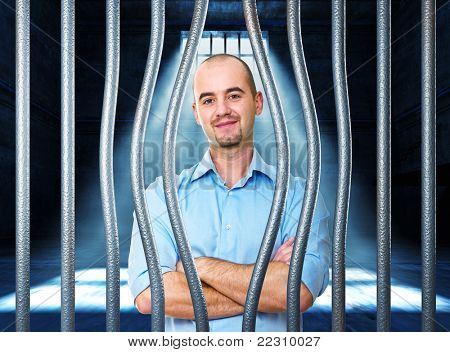 portrait of man in jail with bended metal bar