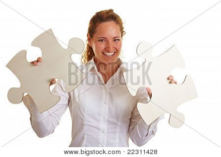 Happy Business Woman With Two Jigsaw Pieces