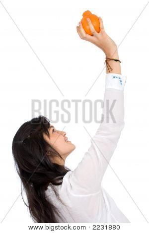 Girl Picking An Orange