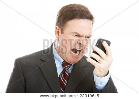 Angry businessman yelling into a cellphone.  Isolated on white.